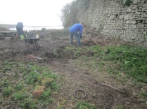 removing nettles, stumps and accumulated soil