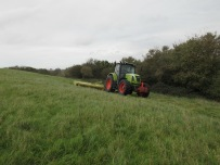 The tops of both hills are mown annually by tractor