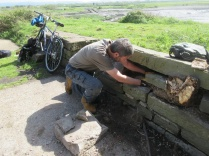preparing a temporary fix by replacing dislodged stones