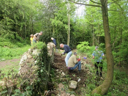 sorting stones and levelling the site prior to a partial rebuild