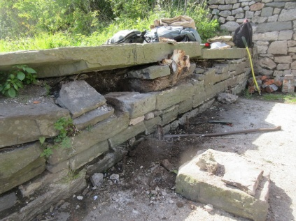 tree roots and antisocial behaviour have taken their toll on this other old wall
