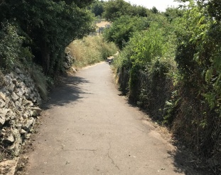 the coast path approaching the cemetery wall