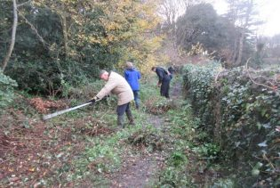 tidying the right of way behind the cemetery allotments