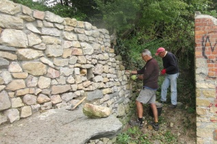 adding to a previously consolidated section of the retaining wall
